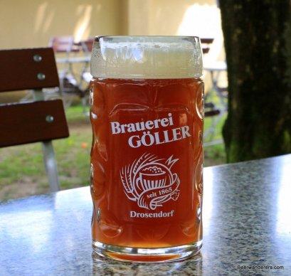 unfiltered amber beer in logo mug