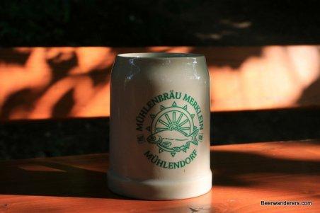 ceramic beer mug in sun with logo