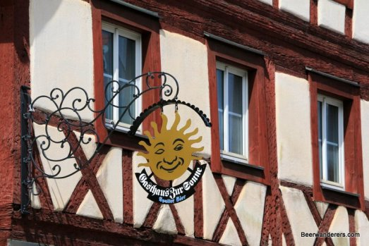 old brewery sign on half-timbered house