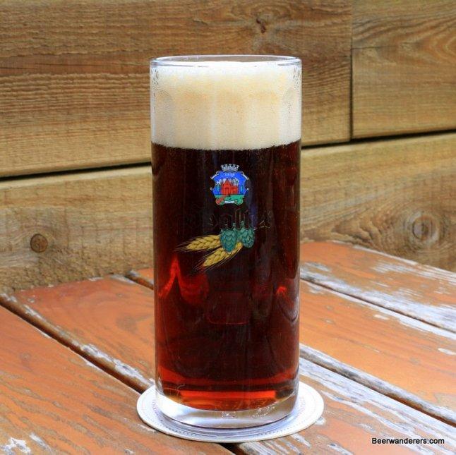 dark beer with big head in logo mug
