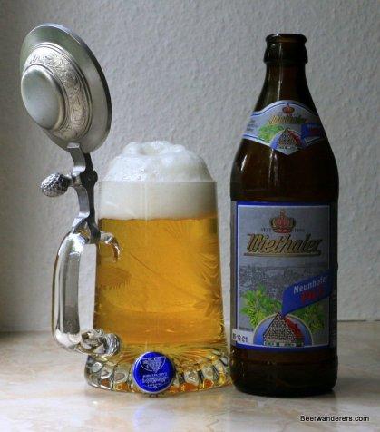 goldern beer in mug with pewter lid and bottle