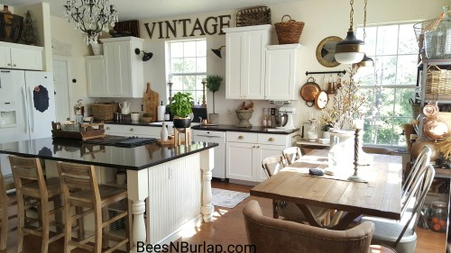 white industrial farmhouse kitchen makeover painted cabinets