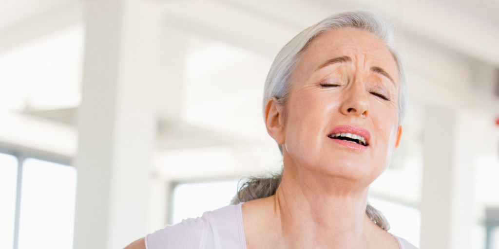 A stressed woman with back pain