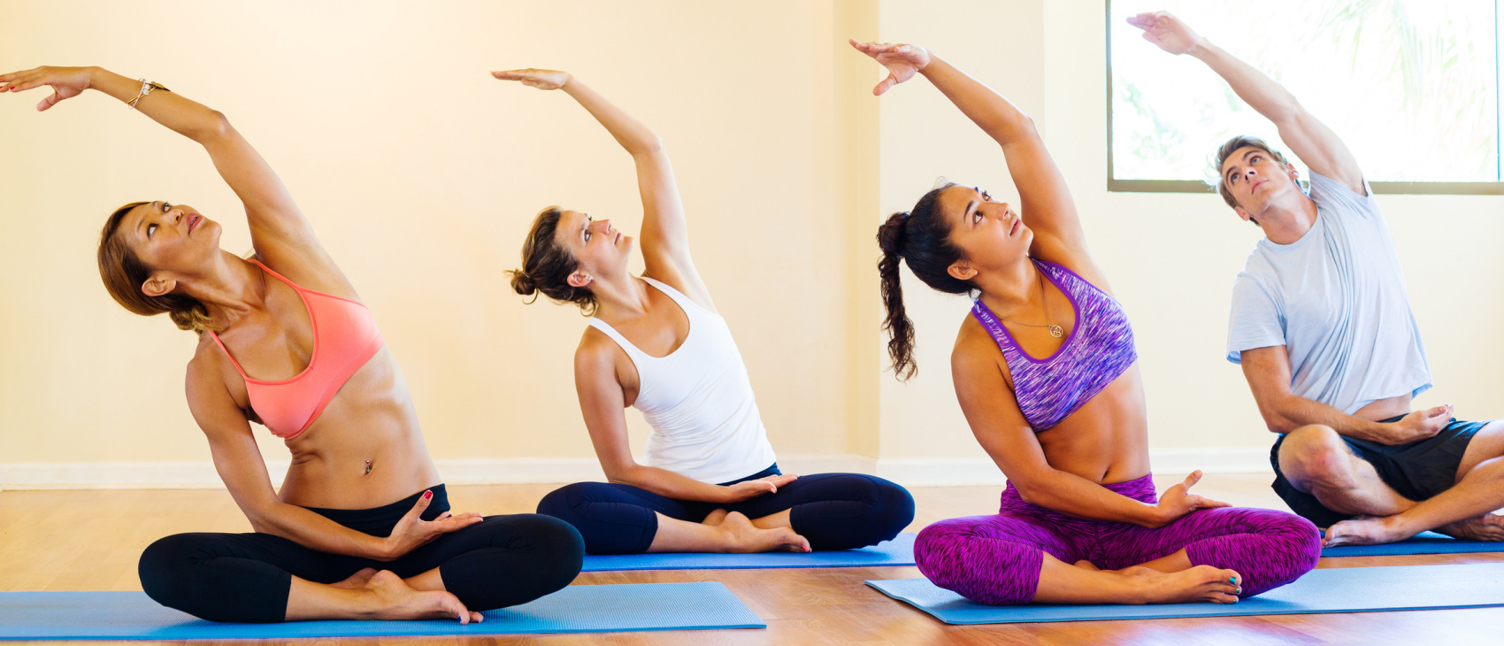 yoga posses man and women