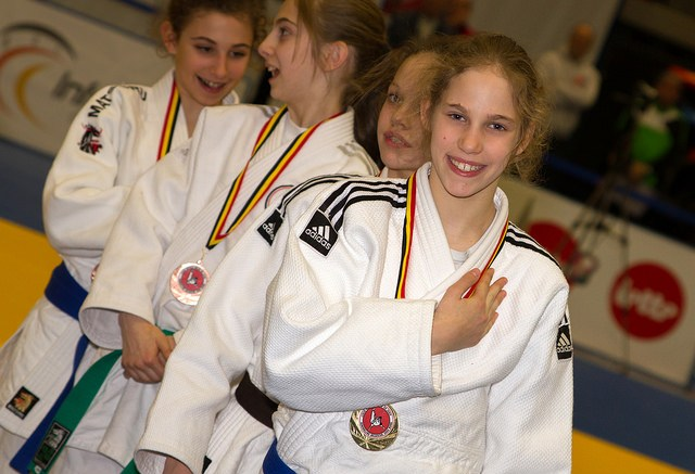 Victorious Judoka wearing their hard earned medals (on the page common victory conditions)