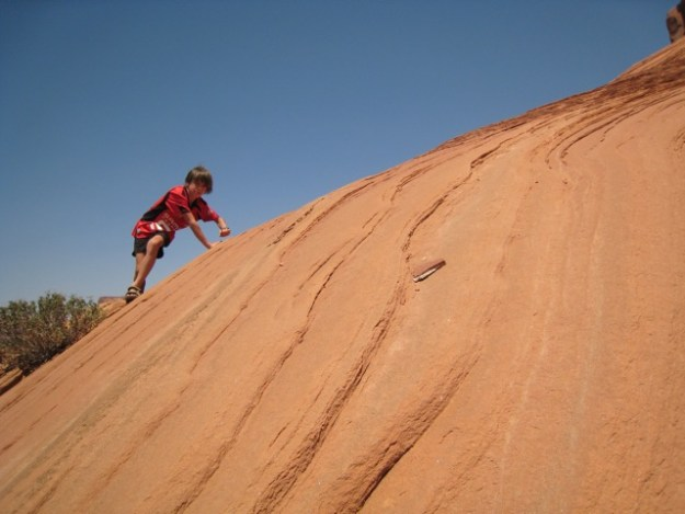 child climbing, Monument Valley