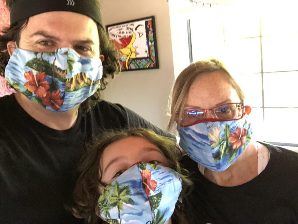 Brendan, Mitchell, and Deirdré wearing matching masks made by Rossella from a Hawaiian shirt