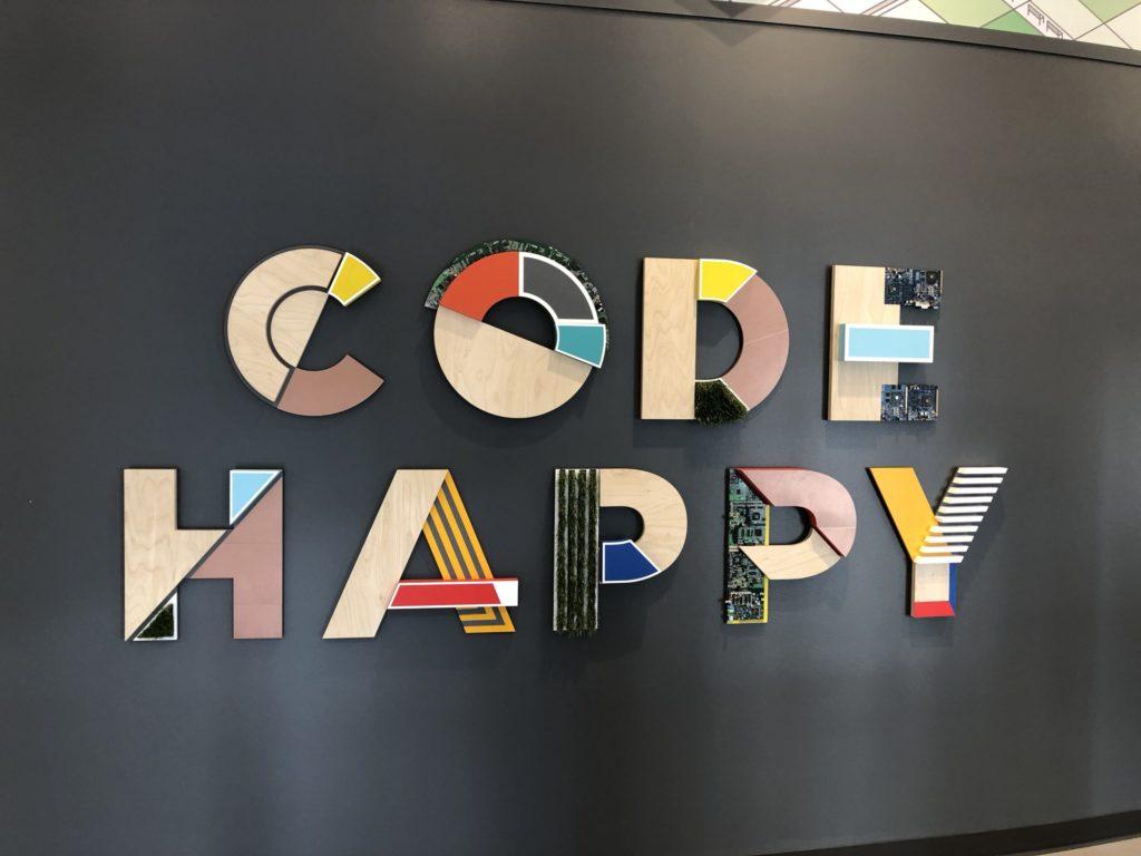 """""""Code happy"""" sign at AWS Loft San Francisco"""