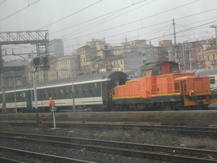 train parked outside Milan Central Station on a gloomy day