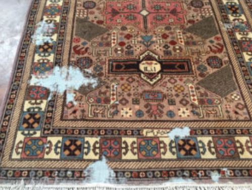 Antique Persian Rug with moth damage