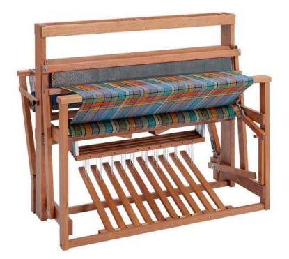 Loom for weaving rugs