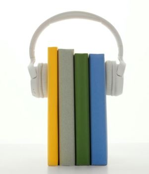 Headphones on a stack of books