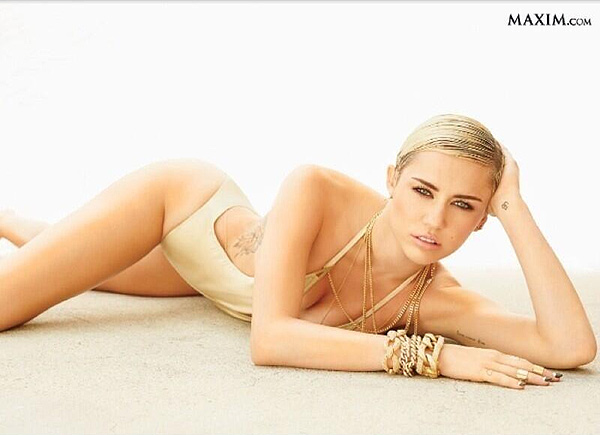 Who is no.1 on Maxim Hot 100 List?