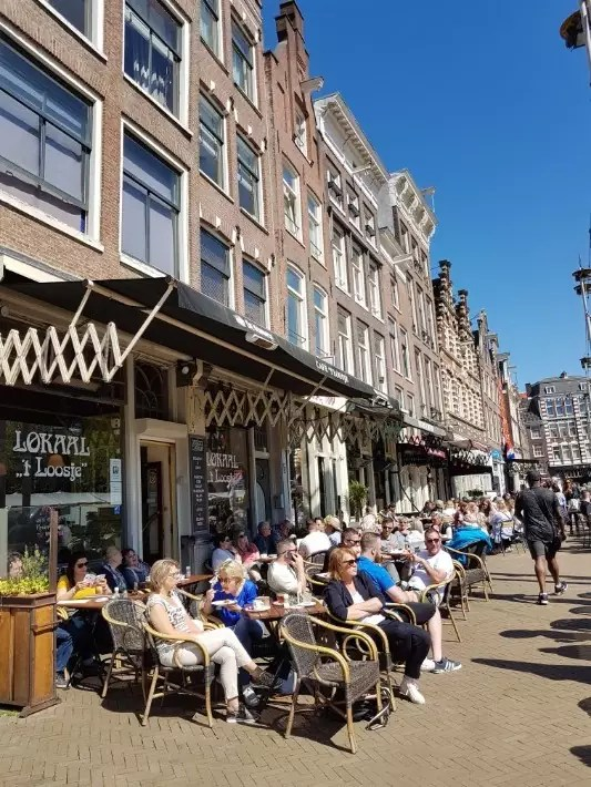 amsterdam cafe summer sun people watch