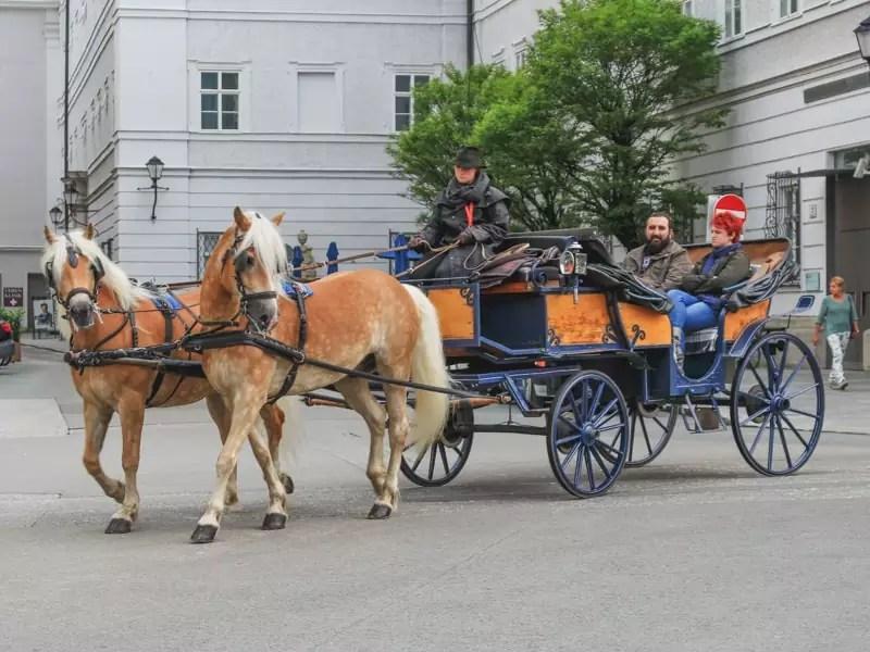 salzburg austria sound of music tour couple horse drawn carriage traditional city centre