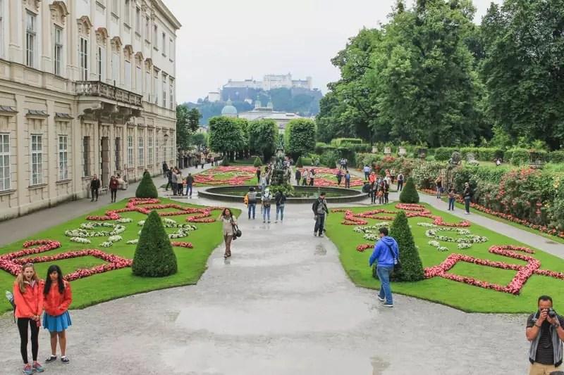 salzburg austria sound of music tour palace gardens tourists ornate formal landscaping
