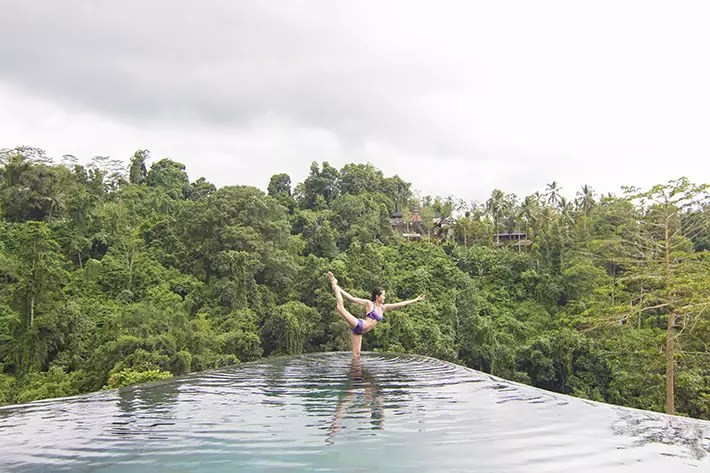 infinity pool girl yoga, hanging gardens of bali ubud