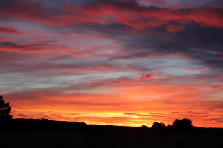 fiery sunset fox glacier new zealand