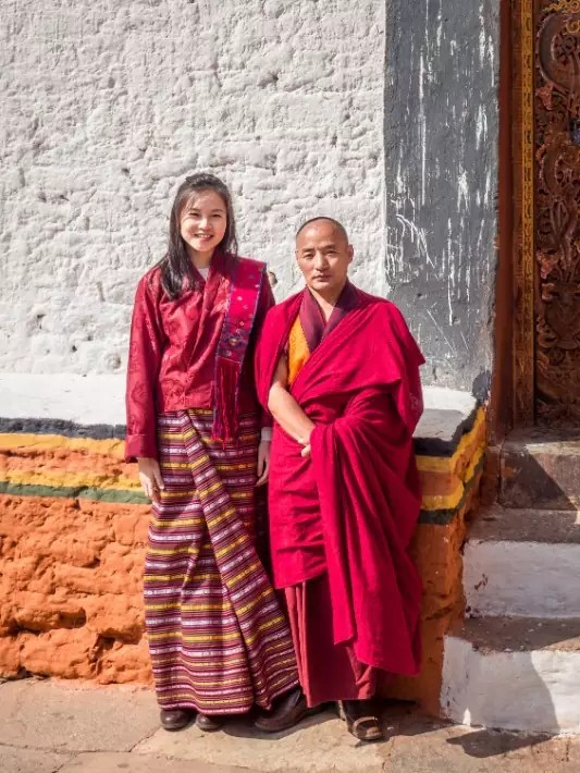 Punakha Dzong, traditional costume, red robed monk, Bhutan