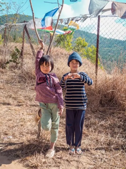 local children, Chimi Lhakhang Phallus Bhutan