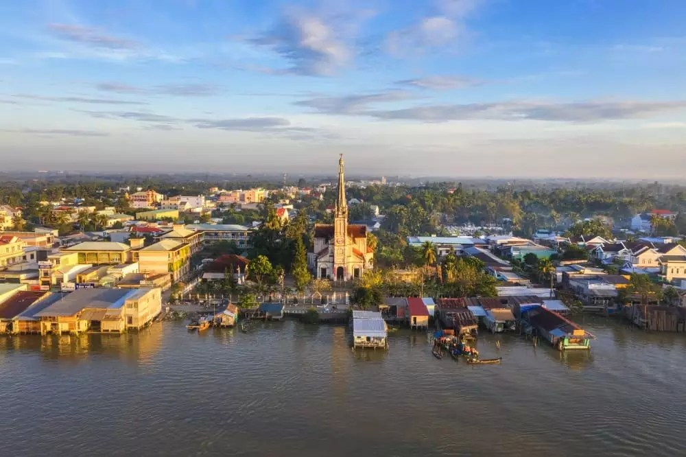 riverside in Cai Be, 15-Day Vietnam-Cambodia Itinerary 14