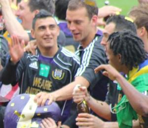 Matias Suarez celebrates the title with Tom De Sutter and friends