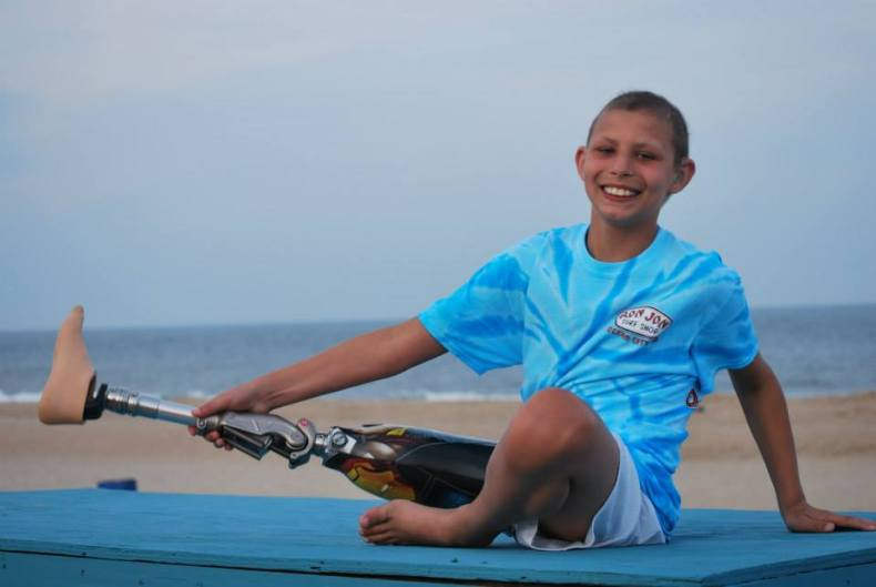 Young boy smiling while enjoying a Believe In Tomorrow respite trip