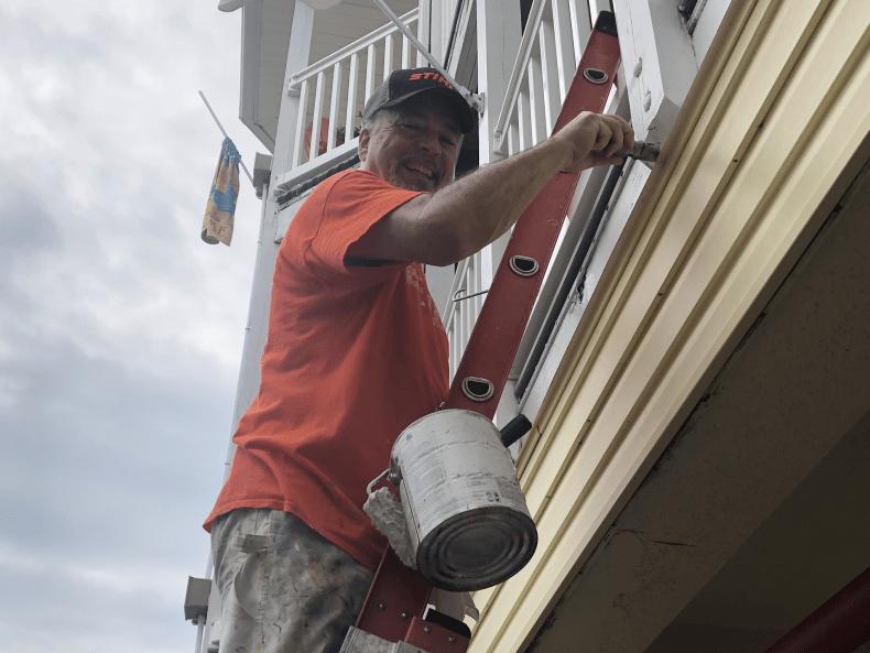 Volunteer painting at Believe In Tomorrow beach properties