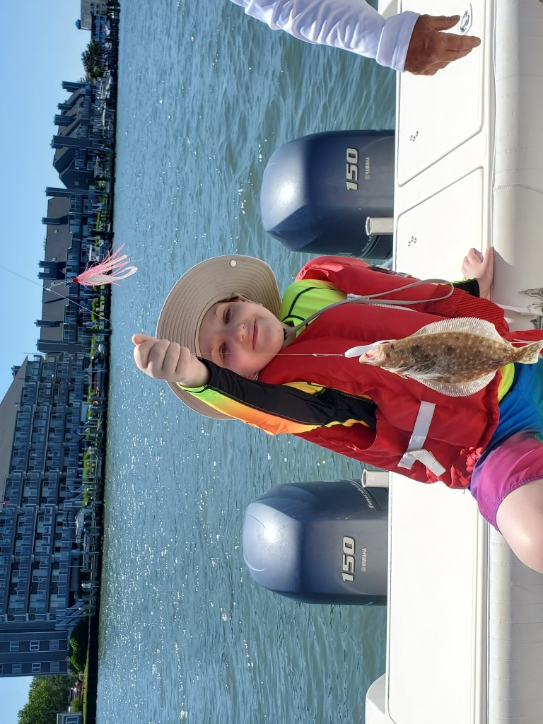 A young on a fishing trip with Believe In Tomorrow Children's Foundation