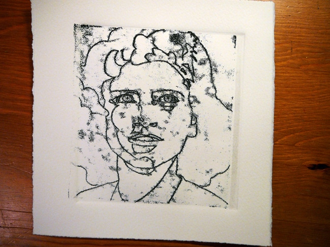 a linear drawing of a woman's face, made via trace monotype with black ink in smoky passages on the paper