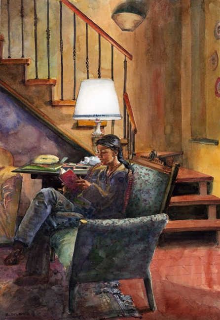 a woman reading a book by a light in a room at the bottom of a stairwell