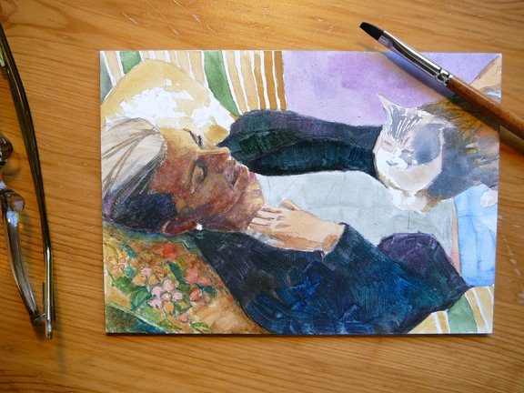 a watercolor of a woman reclining with a cat on her torso in process