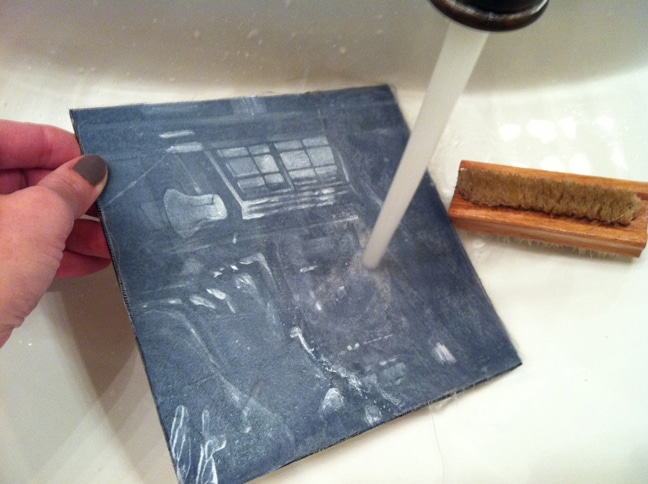 rinsing a sealed silk aquatint plate after printing
