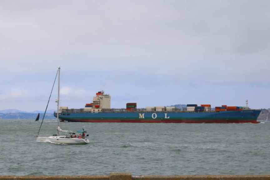 MOL Cargo Ship and a sail boat