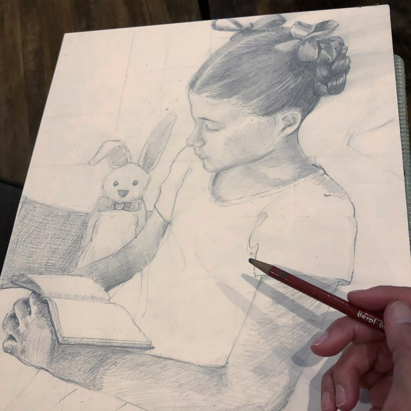 a pencil drawing of a little girl with a book in her lap and a bunny standing by