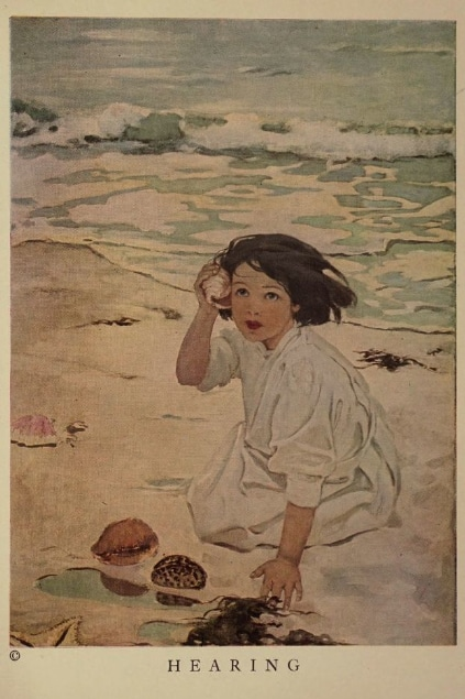 An illustration by Jessie Willcox Smith titled Hearing from the book of the five senses by Angela Marie Kaye, showing a little girl on the beach listening to a shell.