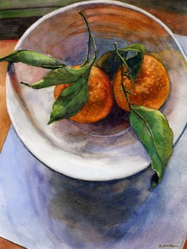 two clementines oranges in a bowl with leaves in the stems that suggest a ying-yang circle