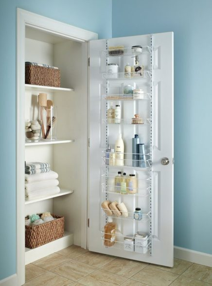 a door mounted closet caddy with shallow shelves to post inside a closet for for added storage