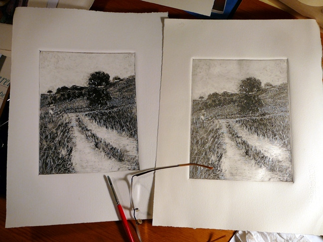 two black and white monotypes of a landscape, with a painter standing in a field at an easel