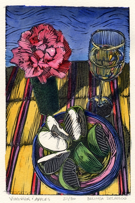 a platter of sliced apples next to a glass of white wine and a single rose in a vase on a striped cloth