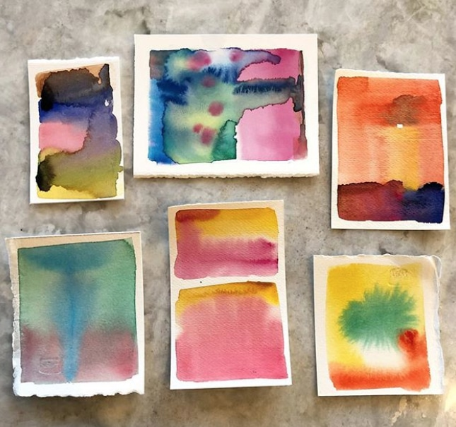Six tiny scraps of watercolor paper with color watercolor washes in random colors