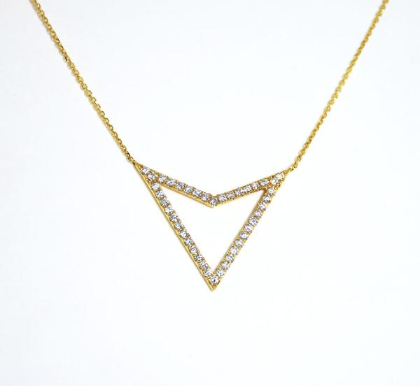A V shaped gold pendant with diamnds