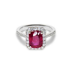 A white gold ring with a ruby and small diamonds
