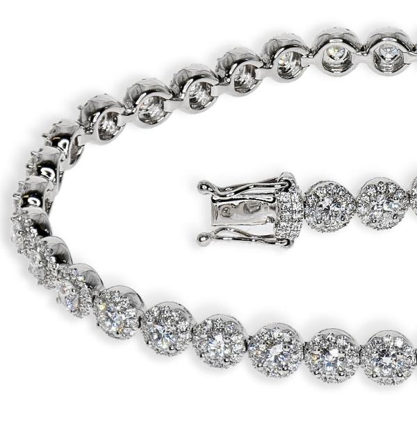 A close up of a white gold and diamond bracelet diamond