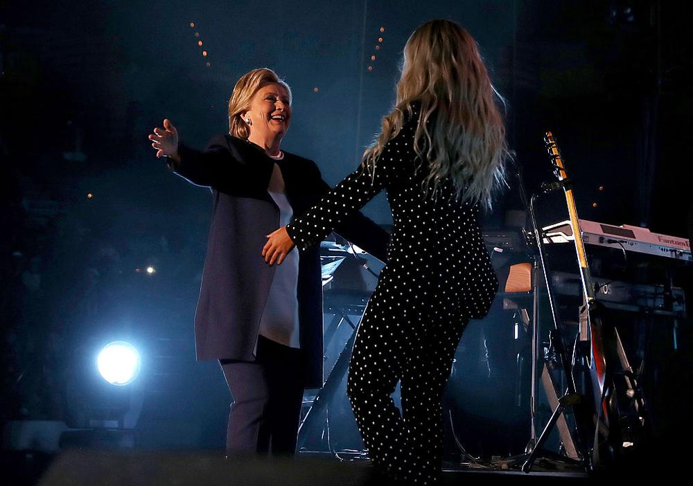 CLEVELAND, OH - NOVEMBER 04: Democratic presidential nominee former Secretary of State Hillary Clinton greets recording artist Beyonce during a Get Out The Vote concert at Wolstein Center on November 4, 2016 in Cleveland, Ohio. With less than a week to go until election day, Hillary Clinton is campaigning in Pennsylvania, Ohio and Michigan. (Photo by Justin Sullivan/Getty Images)