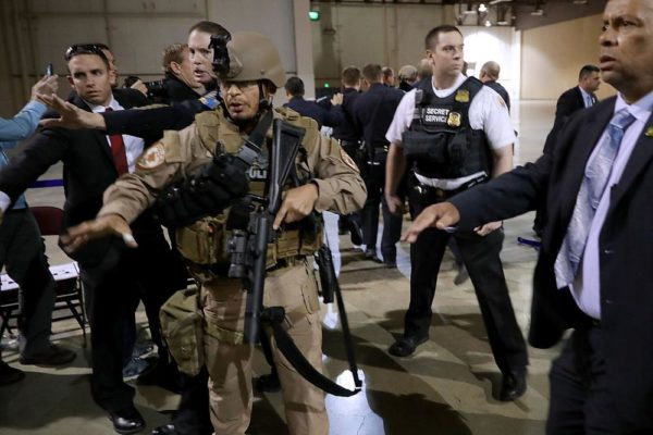 RENO, NV - NOVEMBER 05:  Police officers and U.S. Secret Service rush a man in handcuffs out of a campaign rally for Republican presidential nominee Donald Trump at the Reno-Sparks Convention Center November 5, 2016 in Reno, Nevada. With less than a week before Election Day in the United States, Trump and his opponent, Democratic presidential nominee Hillary Clinton, are campaigning in key battleground states that each must win to take the White House.  (Photo by Chip Somodevilla/Getty Images)