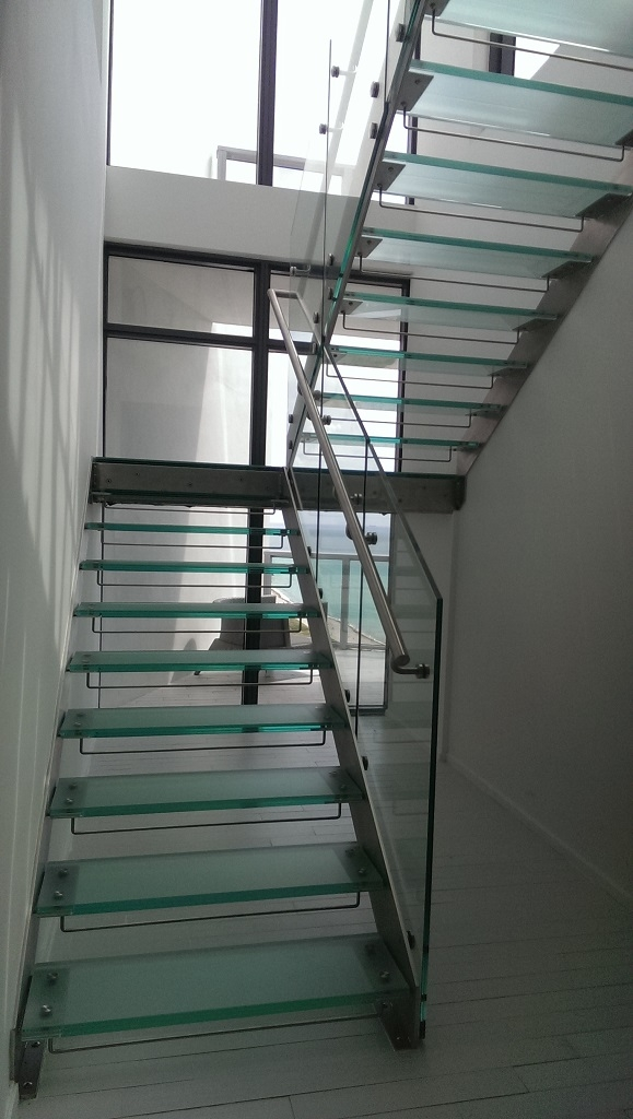 Modern Glass Staircase In South Beach Bella Stairs | Frosted Glass Stair Panels | Smoked | Toughened | Deck | Balcony | Contemporary