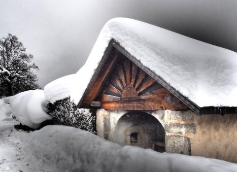 Chalet dans la neige aux Carroz