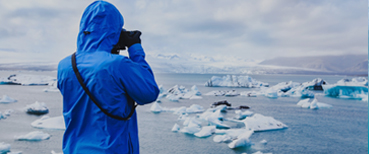 Person Taking Photo of Arctic Icebergs in Iceland - Source: Ditty_about_summer. Person Taking Photo of Arctic Icebergs in Iceland. Digital Image. Shutterstock, [Date Published Unknown]