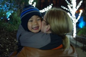 Charlie gets a hug and a kiss from his mama.